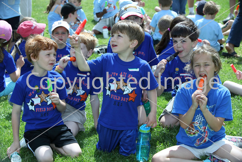 Liam French, Ben Molnar, Christian Heinis, Sam Jackson, and Ainsley Jones devour their popsicles.