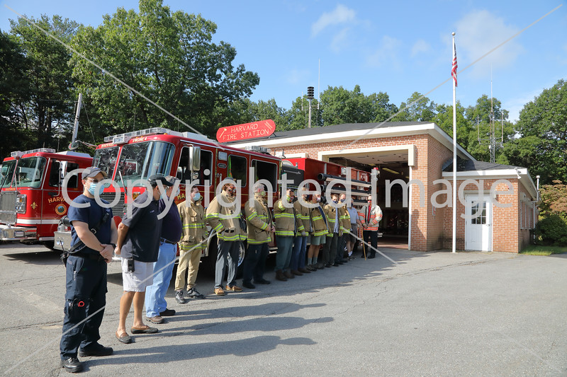 Firefighters and EMTs line up to honor those who perished on Sept. 11, 2001 at the Town Center Fire Station, Sept. 11, 2020. From left: Jason Cotting, Chris Landry, Stephen Into, Mike Devaney, Robert Curran, Joe Miller, Ben Kendrick, Bill Berthoud, Eric Gamage, Dave Hazel, Peter Warren, and Chief Rick Sicard.