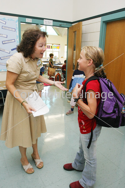 Judy Moore greets former student Caroline Noyes on the first day of school.