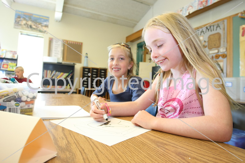 Noah Blaker and Meaghan Mitchell draw pictures.