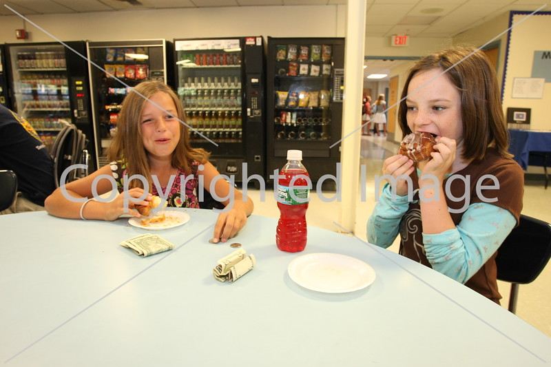 Sixth-graders Eliza Agosta and Lily Holmes enjoy breakfast during their first day in the Bromfield school.
