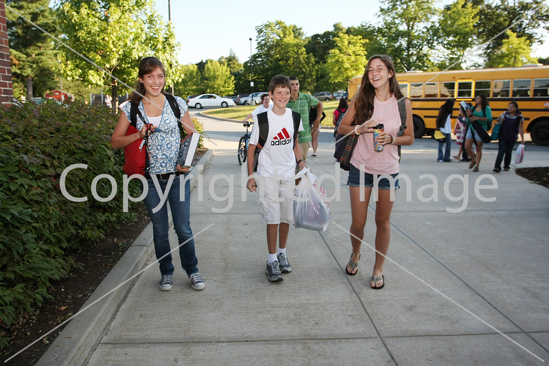 Emily, Sam, and Brittany Jones walk into Bromfield.