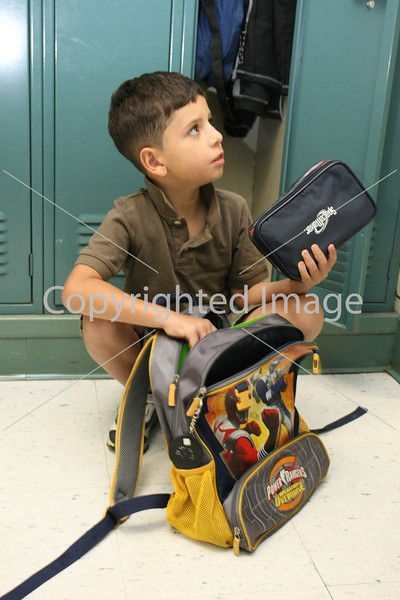 New student Michael Placido prepares for his first day at the elementary school.