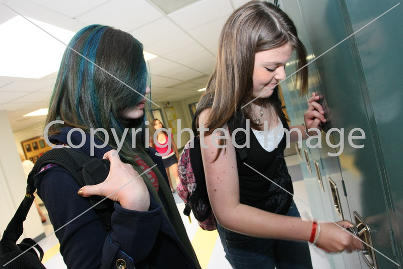 Kaley Pappas and Olivia Rooney (right) start the day off at their lockers.