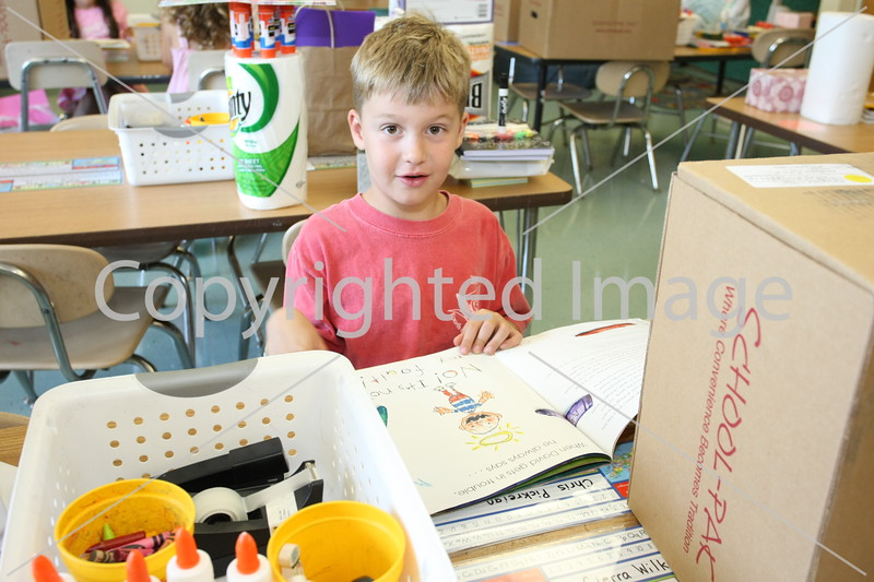 Chris Pickreign reads a book in his new classroom.
