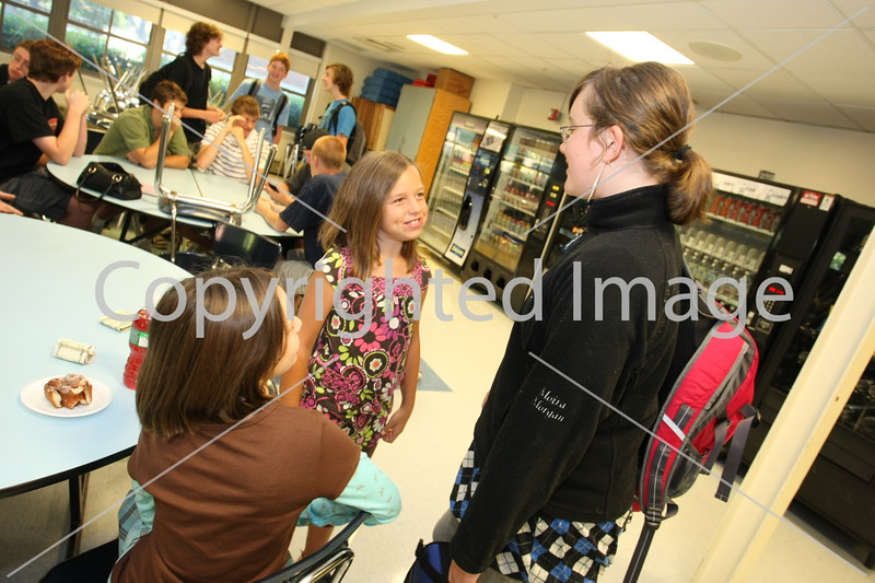 Lily Holmes and Eliza Agosta greet fellow sixth-grader Moira Morgan on their first day in the Bromfield school.