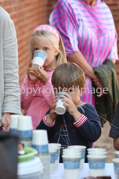 Ethan and Hannah Taylor enjoy their lemonade before the open house.