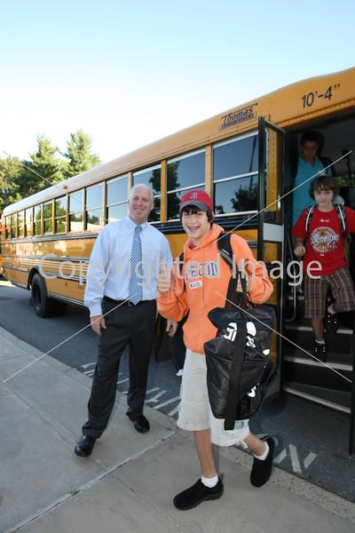Eric Johnson steps off the bus at Bromfield as Principal Jim O'Shea looks on.