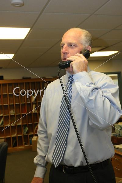 Principal Jim O'Shea wlecomes students back during morning anouncements.