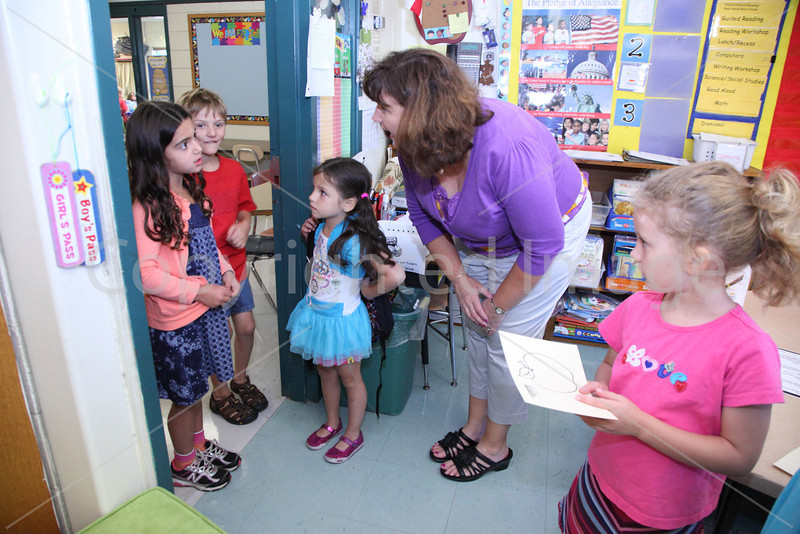First-graders are greeted by their teacher Lisa Hopkins.