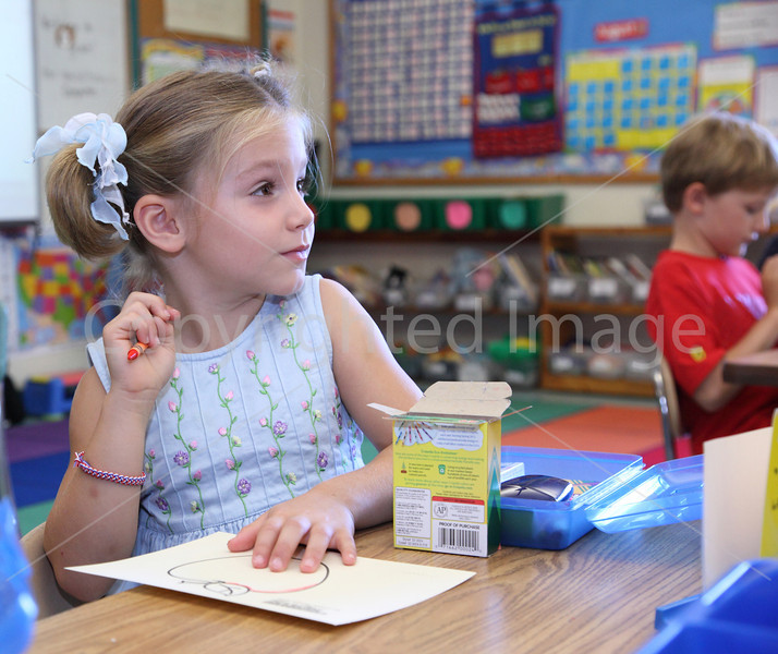 First-grader Allison Correiri surveys the classroom on her first day at HES.