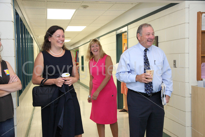 HES Principal Linda Dwight, kindergarten teacher Barbara Ann Gould, and Superintendent Joe Connolly share a laugh as the day begins.
