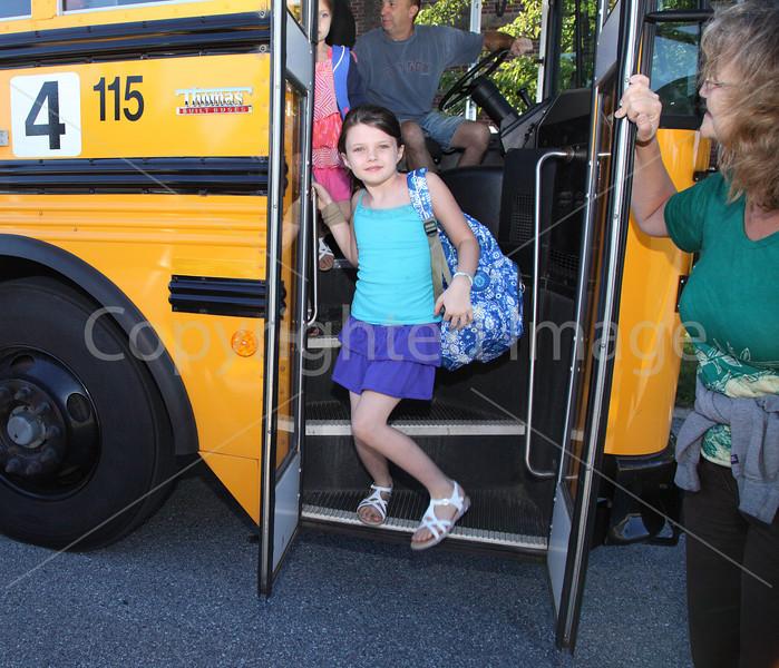Erin Flynn steps off Bus 4