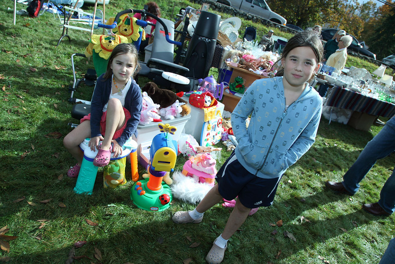 Sydney Machado and her cousin Abbie Zajac sell their outgrown toys.