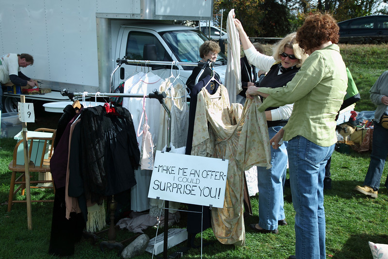 Katherine Grant and Tracey Bird of Townsend check an antique dress.