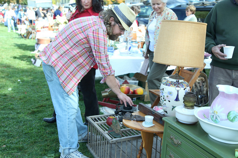 Jeff Venier looks for hidden treasure at the flea market.