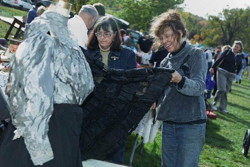 Susan Pescatore and Josie Carothers check out an antique skirt.
