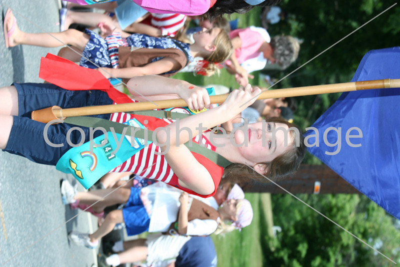 Jane Sullebarger leads the Girl Scouts in the fourth of July parade.
