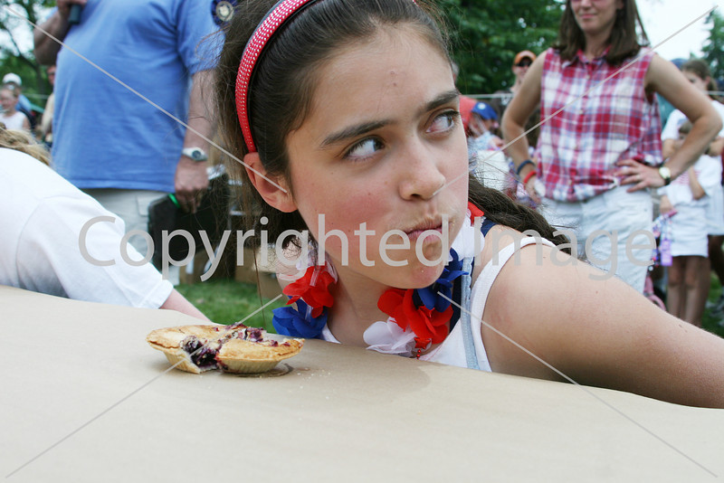Mackenzie Grant glances over her shoulder during the pie eating contest. (Photo by Lisa Aciukewicz)