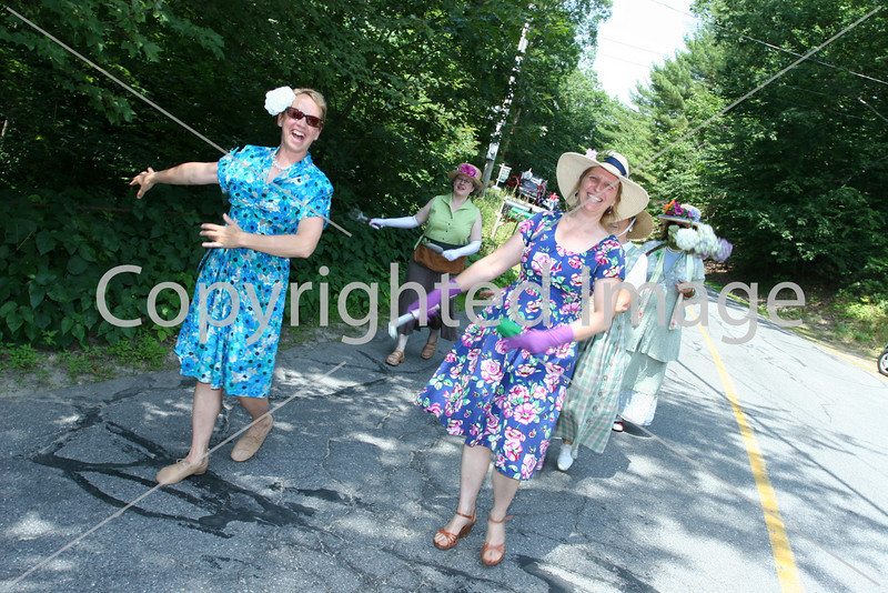 Garden club memebers Alice Gerbura, Rachel Ogelsby, and Mary Vesenka Turner practice dancing before the parade. (Photo by Lisa Aciukewicz)