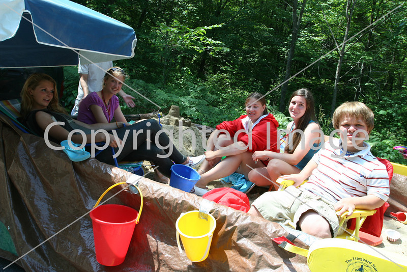 Great day for the beach! Elise Bilodeau, Kathryn Kennedy, Kayti Begelow, Kira Broganer, and Tyler Mitchell relax on the lifeguard's float before the parade. (Photo by Lisa Aciukewicz)