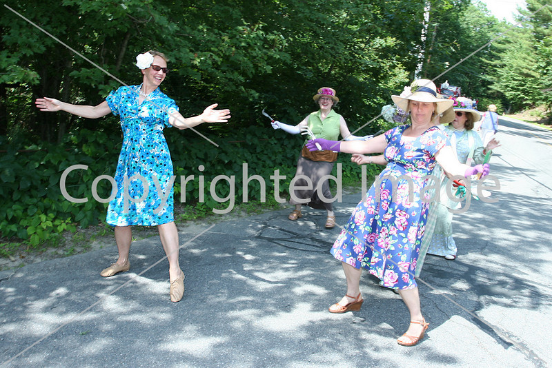 Garden club memebers Alice Gerbura, Rachel Ogelsby, and Mary Vesenka Turner do a warmup shimmy before the parade. (Photo by Lisa Aciukewicz)