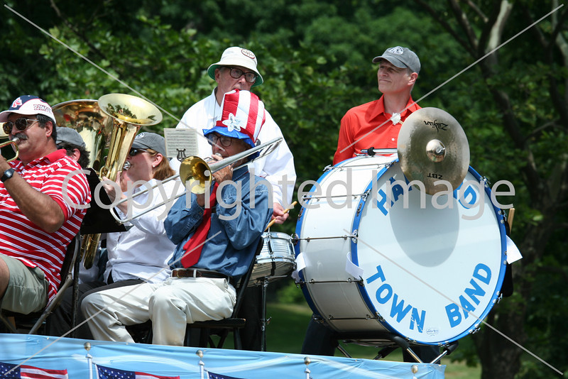 A regular at the parade, the Harvard Town Band serenades the crowd in front of the general store.