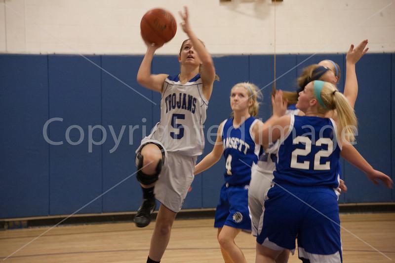 Amy Jorgensen jumping for a basket.