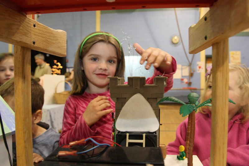 Julia Clark check out a project called the super solar air filter at the Earth Day Fair held at the elementary school last Tuesday.