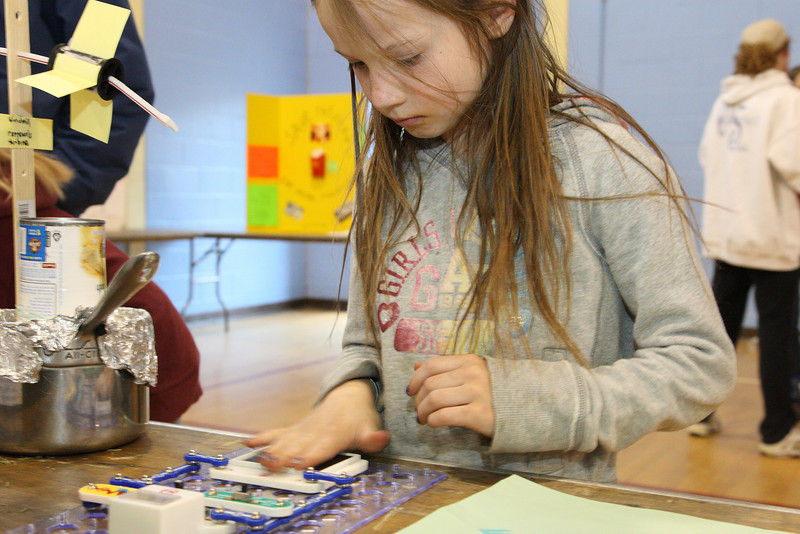 Rachel Ferguson checks out a circuit board at the Earth Day Fair held at the elementary school last Tuesday.