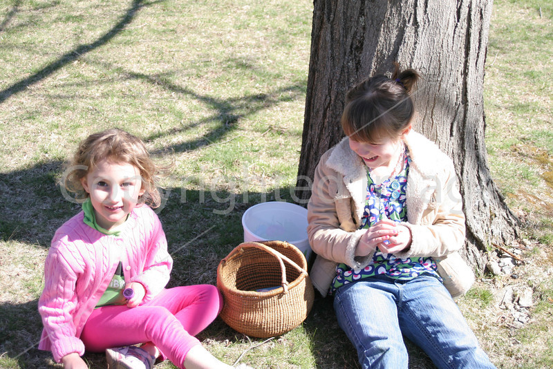 Ela Oneil and Mary relaxing by a tree counting their eggs.