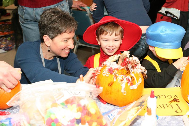 Risa Goldman and son Sawyer create a curly headed pumpkin.