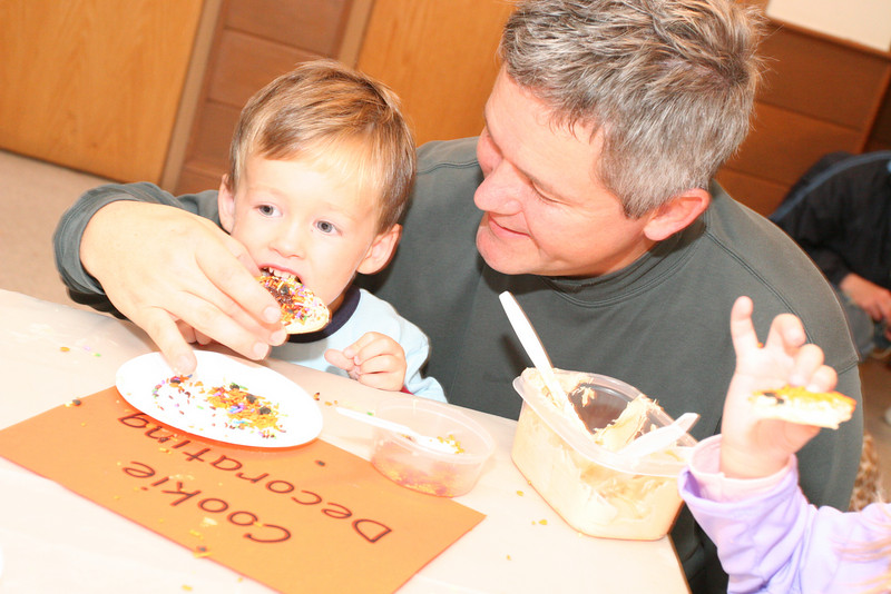 Liam Morrison enjoys a cookie after decorating it with the help of his dad, Bart.