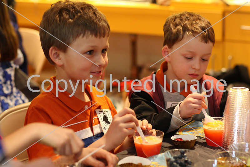 Lucas (left) and Alex Castro mix up their magical liquids in a potions class a the Girl Scouts Harry Potter party at the library on March 16.
