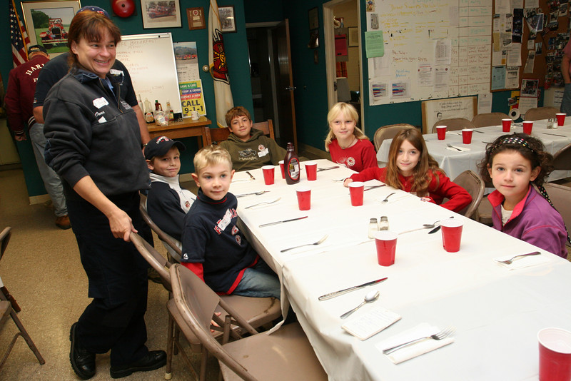 Firefighter Oona Aldrich takes breakfast orders from the winners of the 2007 fire and life safety constest. Left to right are Sam Rosenfield, Will Squire, Chris West, Kate Toll, Arielle Sclar, Alexandra O'Neil