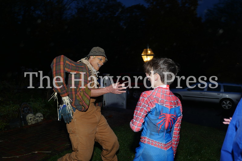 Harvard Halloween 2019 Windy, rainy and warm.<br /> <br /> Donnie Phillips, trapped inside scarecrow, begs to be rescued by passers by like Spiderman to no avail.
