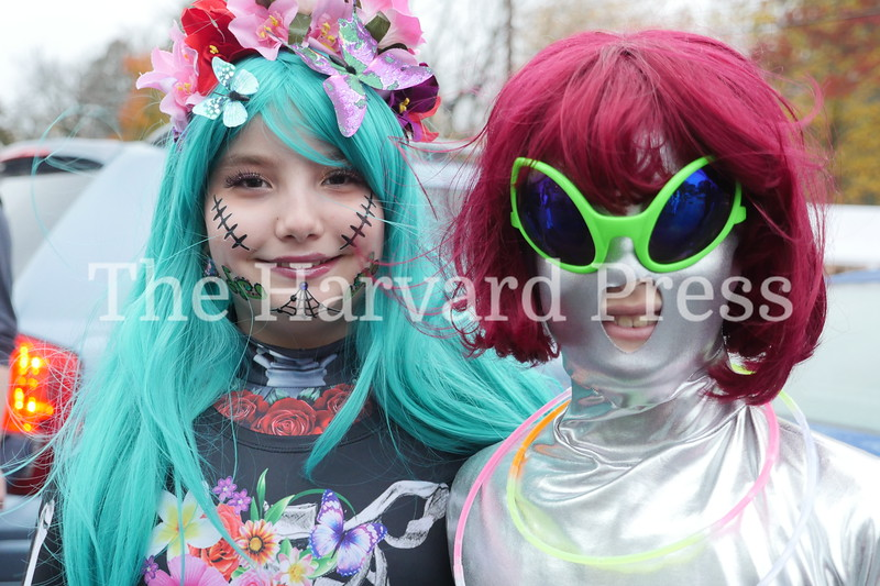 Harvard Halloween 2019 Windy, rainy and warm.<br /> <br /> Audrey Burek and Catherine Berry just visiting from a nearby planet…