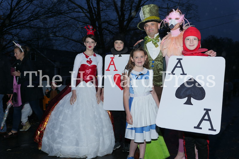 Harvard Halloween 2019 Windy, rainy and warm.<br /> <br /> New Town Center residents, The Maglothin Family, fall down the rabbit hole with Alice (Clara), Queen of Hearts (Ellie), the Mad Hatter (Michael), Rabbit (Hilary) and the Aces (Alistar and Atticus)