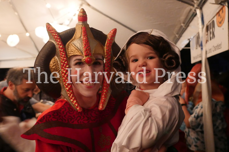 Harvard Halloween 2019 Windy, rainy and warm.<br /> <br /> Padamé Amidala (Sarah Tufano) and young Princess Leia (Willa Meserve) landed at the Lion's club tent on a resupply mission.