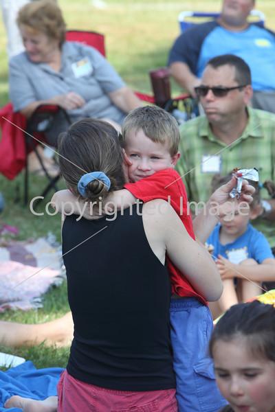 Harry Burns checks in with mom with a spontaneous hug.