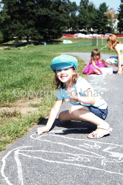 Chloe Palmer looks up from her chalk art.