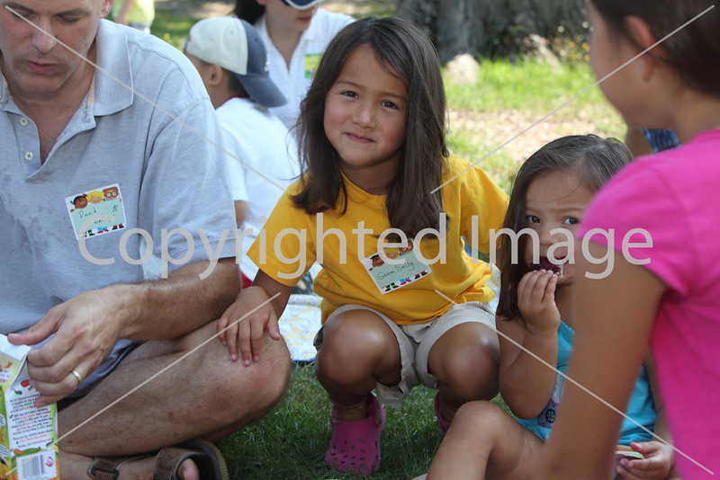 From left, David Seligs picnics with daughters Sara and Anna.