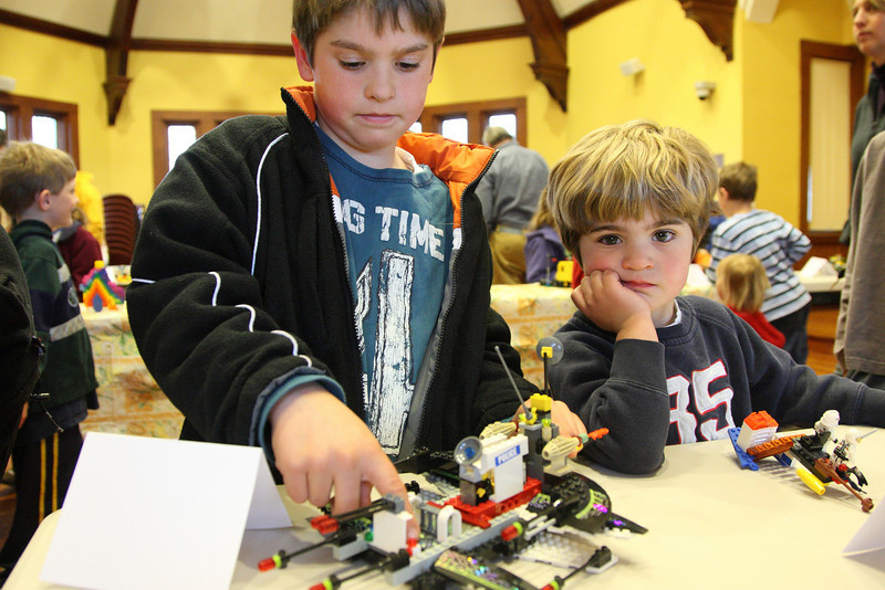 Jack Allen shows off the features of his space ship as brother David Allen waits for his turn.