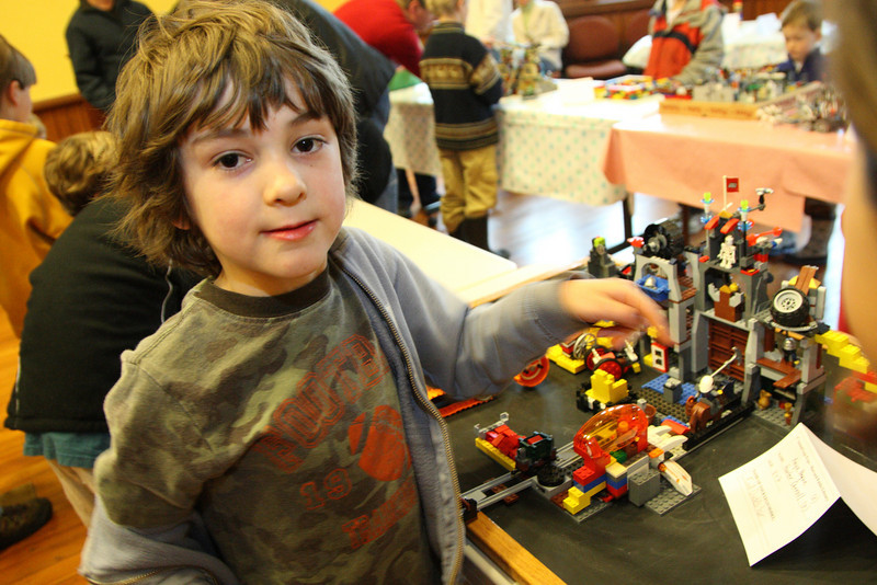 Hunter Carroll shows off the project Evil Dude's Lair project that he and co-creator Anya Beague entered in the Lego Expo at the library last weekend.