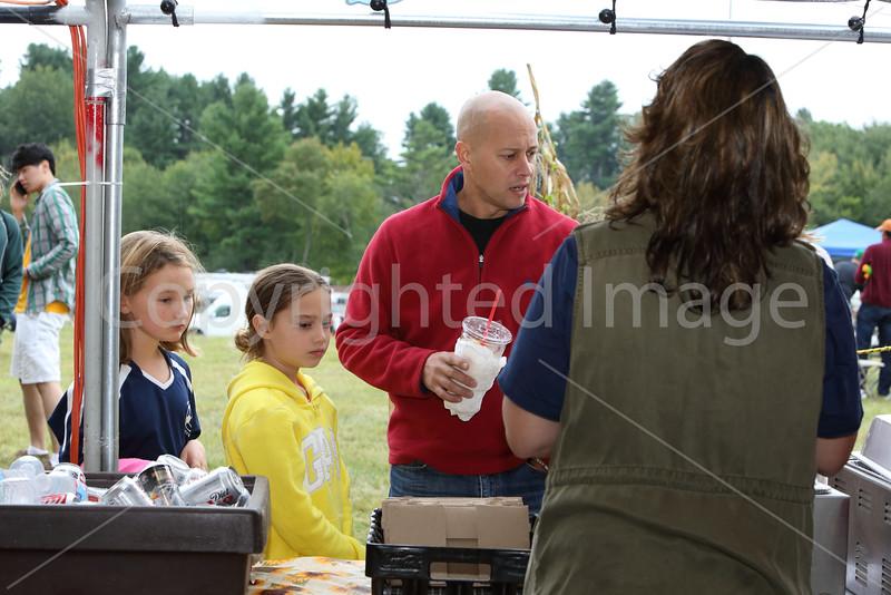 From left: Caroline Maiore, Sophie Boucher and Greg Boucher order some dinner.
