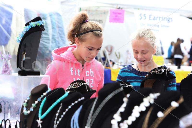 Kaia Bishop and Hannah Taylor look at jewelry.