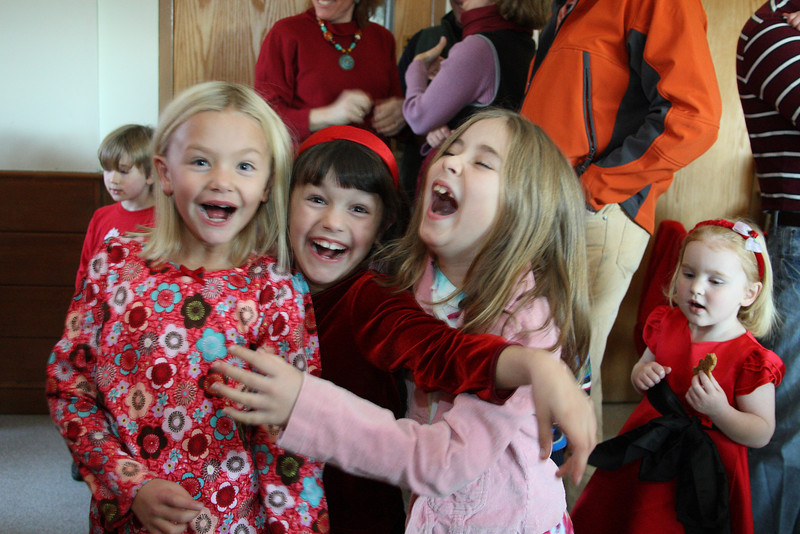 Hayley Minar, Emily Brown, and Madison Drummey share their enthusiasm as they wait to meet with Santa.