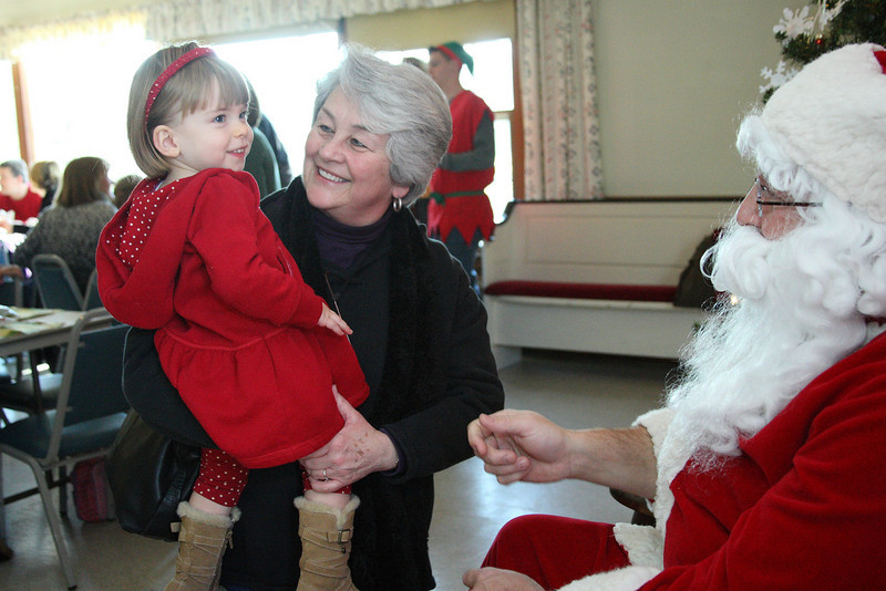 Cassidy Lee is nothing but smiles as her grandmother Lee delivers her to Santa at the Congregational church's annual lunch with Santa last Saturday.