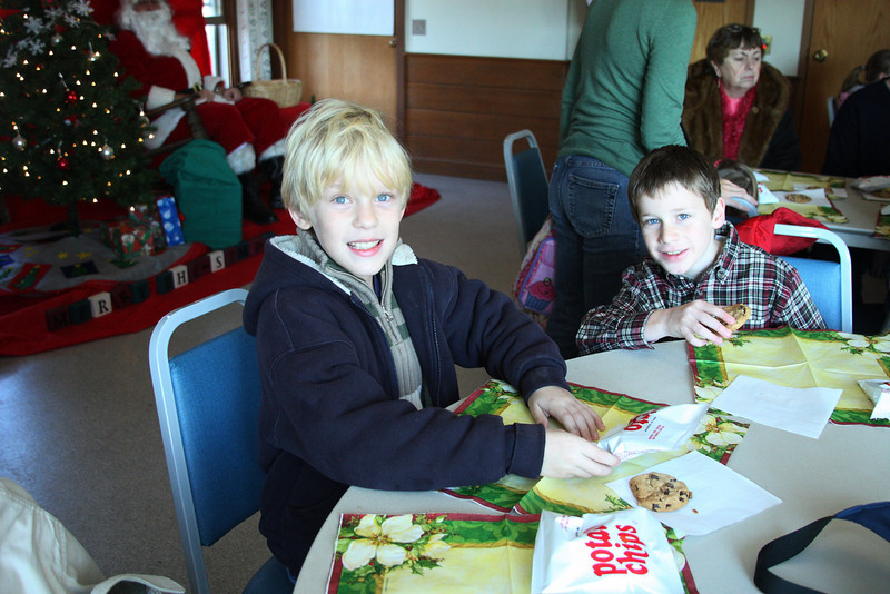 Colin Cleary and Jack Shelton try out cookies before lunch with Santa.