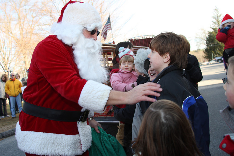 Santa greets John Bakis as he arrives in front of the Congregational church for a breakfast in his honor last Saturday.